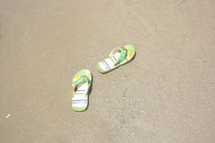 Slippers on a beach Royalty Free Stock Image