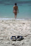 Slippers on the beach Stock Photo
