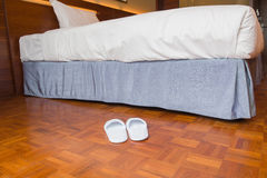 Slippers and bed Royalty Free Stock Photos
