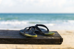 Slippers on the bench by the beach Stock Photo