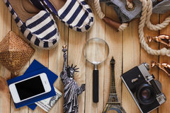 Slippers, camera, phone, miniature of the statue of liberty and Eiffel Tower Royalty Free Stock Photography