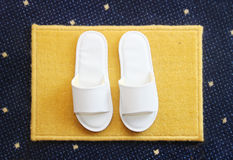 Slippers on carpet background Stock Photos