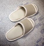 Slippers on carpet floor Stock Photos