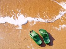 Slippers on coast. Slippers have remained on coast by the water Royalty Free Stock Photography