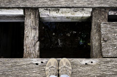 Shoes on the edge of a trash pit Royalty Free Stock Photos