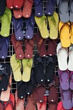 Slippers galore. An array of colourful slippers hanging on a display rack royalty free stock photography
