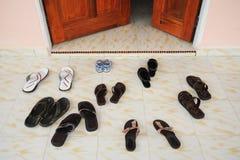 Slippers infront of door Royalty Free Stock Photos