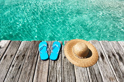 Slippers at jetty. Slippers and hat at jetty by the sea Royalty Free Stock Photography