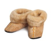 Slippers made ??of natural goat fur. With lace stock image