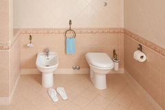 Slippers Near Bidet In Home Bathroom Royalty Free Stock Photo