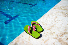 Slippers near swimming pool royalty free stock images