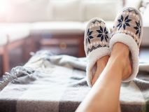 Free Slippers On Women`s Legs Stock Image - 106912421