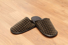 Slippers on the parquet floor Royalty Free Stock Images