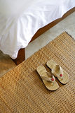 Slippers and part of blanket, hospitality concept Royalty Free Stock Image