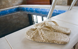 Slippers at the pool Royalty Free Stock Image