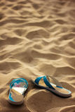 Slippers in sand Royalty Free Stock Photography