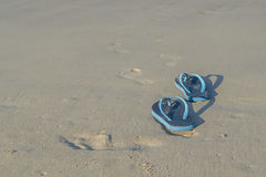 Slippers on the sand beach Royalty Free Stock Image