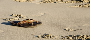Slippers on sand Royalty Free Stock Photography