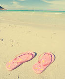 Slippers on sand Royalty Free Stock Image