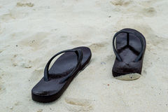 Slippers on a sandy Stock Photo