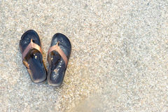 Slippers on the sea. A Slippers on the sea Royalty Free Stock Image