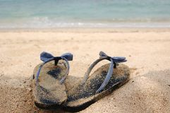 Slippers at the sea Stock Photo