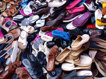 Slippers and shoes stock images