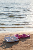 Slippers on the shore Royalty Free Stock Photography