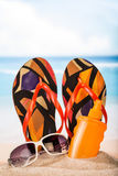 Slippers, sunblock and sunglasses Stock Photography