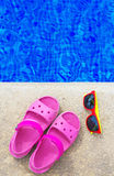 Slippers and sunglasses. Stock Photos
