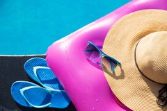Slippers sunglasses straw hat pink air mattress Royalty Free Stock Image