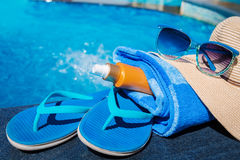 Slippers sunscreen cream towel hat sunglasses Royalty Free Stock Image