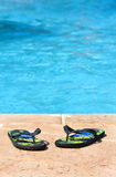 Slippers in the  swimming pool Stock Images