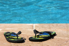 Slippers in the swimming pool Royalty Free Stock Photo