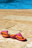 Slippers in the swimming pool Royalty Free Stock Images