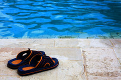 Slippers in the swimming pool Royalty Free Stock Image
