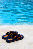 Slippers in the swimming pool Stock Photography