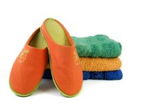 Slippers and towels Stock Photo
