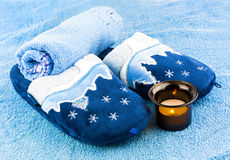 Slippers with towels and candle. Slippers with blue towels and candle in candlestick Stock Images