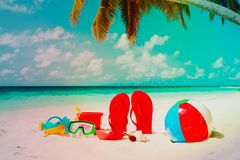 Slippers, toys and diving mask at beach. Slippers, toys and diving mask at tropical beach Stock Photography
