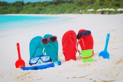 Slippers, toys and diving mask at beach. Vacation concept Stock Image