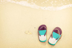 Slippers on tropical beach in summe. Retro slippers on tropical beach in summer - vintage color tone effect Stock Images