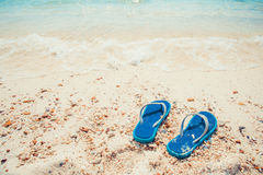 Slippers on tropical beach Stock Photos