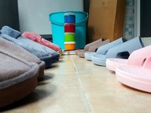 Slippers of various colors arranged in neat rows. stock photos