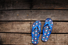 Slippers on the wood floor. At Resort Thailand Royalty Free Stock Photo