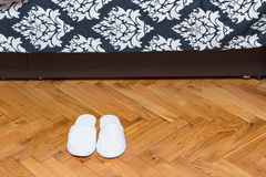 Slippers on wooden floor Stock Image