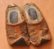 Slippers. Worn pair of slippers on a homogeneous background closeup Stock Photos