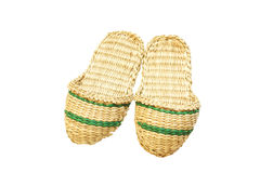 Slippers woven from straw. Isolated on white. Stock Photos