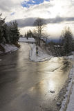 Slippery dangerous road in icy conditions Stock Images