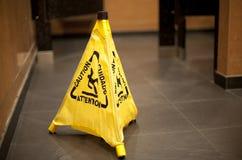 Slippery Floor. Caution sign about slippery floor Stock Photos